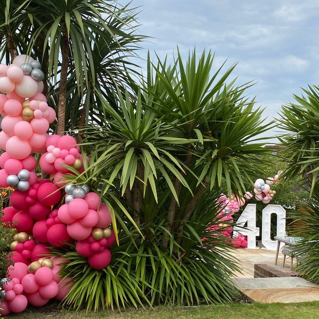 tropical party at home pink balloons palm tree