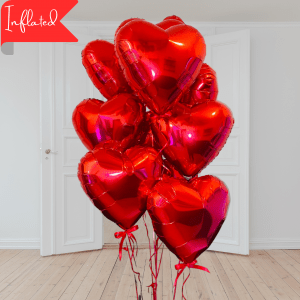 bunch of red heart shaped valentines balloons