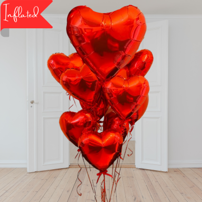 large red valentines heart balloon with medium red valentines heart balloons