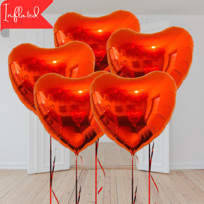 Five red valentines heart balloons