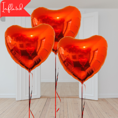 Three red valentines heart balloons