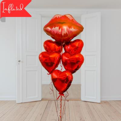 lip shaped helium balloon and five heart balloons