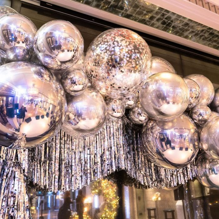 Christmas party silver and confetti balloons and tinsel